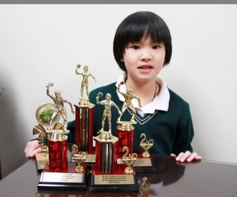 Laura, Gr. 4, with her table tennis trophies