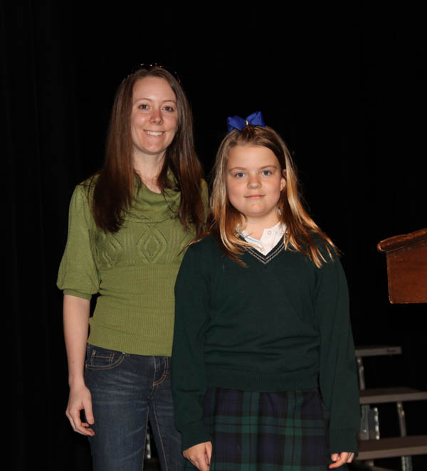 Zoe, Gr. 4, introduces SFU Graduate Student Amanda Kissel at a special assembly.