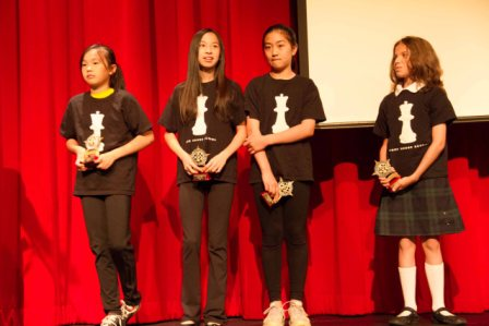 The girls with their trophies, Jr. School Assembly.