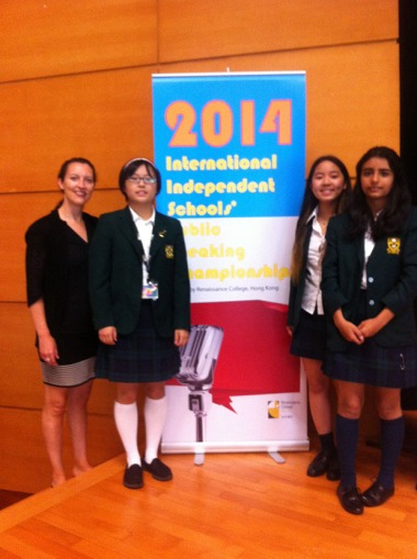 Ms. Harrigan, Rainy, Fraser and Rosa at the International Independent Schools Public Speaking Tournament in Hong Kong.