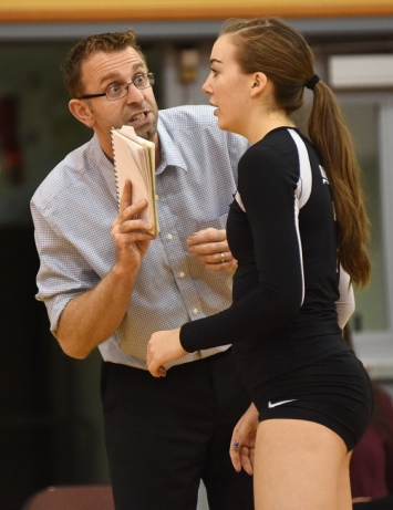 Head coach Chris Ruse speaks with Kaleigh (No. 7) during a playoff game at York House Nov. 6, 2014. Photo Dan Toulgoet.