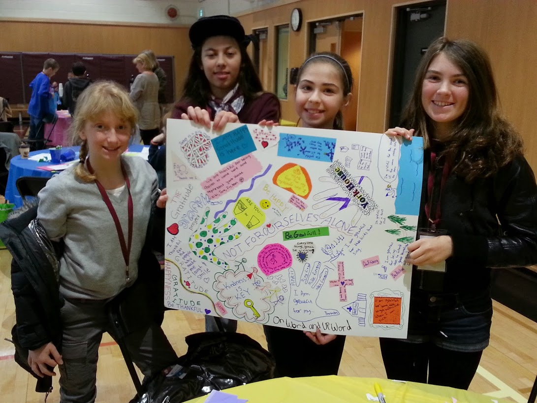 Gr. 6 students Aeon, Kiara, Tera, and Ivy with their Gratitude Graffiti poster.