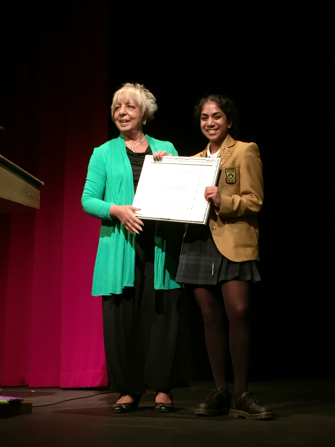 Pummy Kaur, from P.A.G.E, presents Anjali with the Gandhi Peace Award. Senior School Assembly, March 3, 2015.