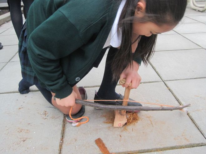 Grade 7 Primitive Project: practicing making friction fires with a bow drill kit