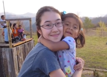 Angela, Gr. 11, with Maeli, at Project Somos. Spring Break 2014.