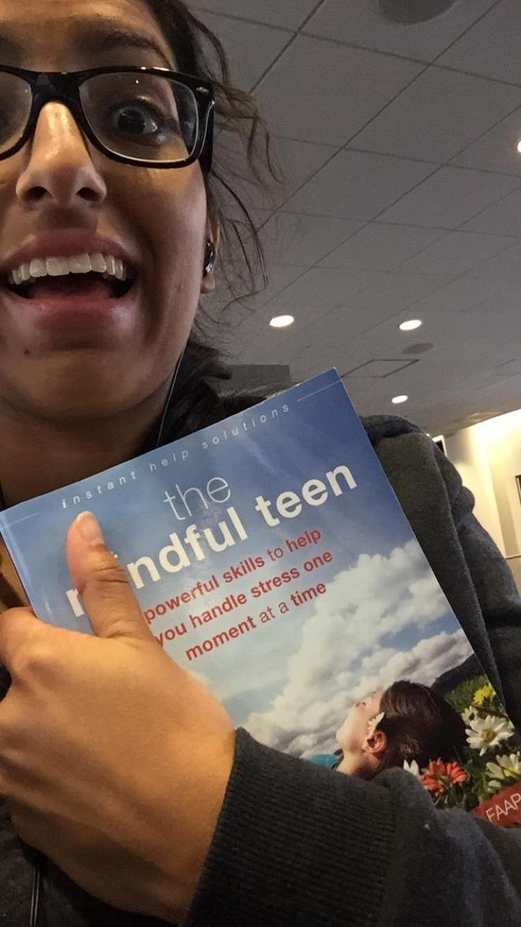 "Manpreet, Gr. 12, with ""The Mindful Teen"" book"