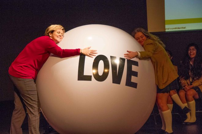 Mme. Rousseau and Head Girl Helen with the Big Love Ball at the Sr. School assembly.